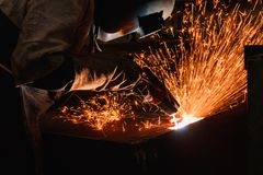 Welder arc Gouging carbon  with sparks and smoke. Welder arc Gouging carbon electrode rods   with sparks and smoke Royalty Free Stock Image