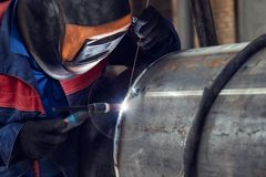 Welder, arc welding and weld seam close-up stock images