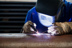 Welder in blue suit with proper protection Royalty Free Stock Photography