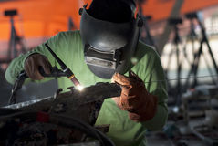 Welder Boat. A welder in working area Royalty Free Stock Photography
