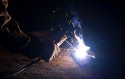 Welder brews metal. Welder brews of the metal constructions Stock Image