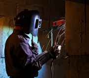 Welder brews metal constructions. For pipes Royalty Free Stock Photo