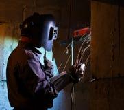 Welder brews metal constructions Royalty Free Stock Photo