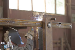 Welder brews metal structure in the shop Royalty Free Stock Images