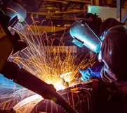 Welder and bright sparks. Construction and manufacturing Royalty Free Stock Image