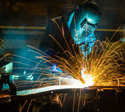 Welder and bright sparks. Construction and manufacturing Stock Photos