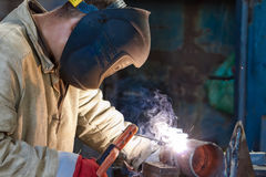 Welder busy parts of the pipeline Stock Images