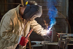 Welder busy parts of the pipeline Royalty Free Stock Photos