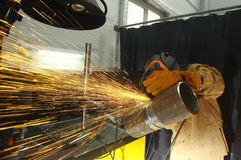 Welder. Cleaning of the finished weld seam. Welding of the pipeline at the competition of professional skill Stock Photo