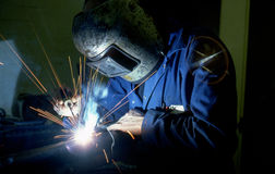 Welder. Close up of a engineer arc welding a pipe Stock Image