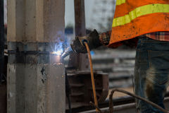 Welder at construction site. Welder working at construction site Stock Photo