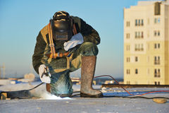 Welder at construction site. Welder working with electrode at arc welding in construction site winter outdoors Stock Photos