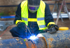 Welder covered with  protective mask Stock Photos