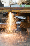 Welder cutting metal at factory workshop Royalty Free Stock Photo
