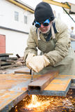 Welder cutting metal sheet Stock Photos