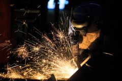 Welder is cutting steel frame by carbon air arc gouging. Welder is cutting frame by carbon air arc gouging Stock Photos