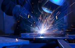 Welder erecting technical steel. Industrial steel welder in factory technical Royalty Free Stock Photo