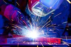 Welder erecting technical steel. Industrial steel welder in factory technical Stock Photography