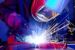 Welder erecting technical steel Royalty Free Stock Photos