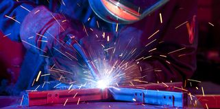 Welder erecting technical steel Royalty Free Stock Images