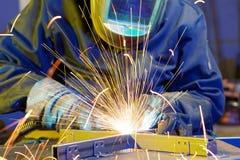 Welder erecting technical steel Royalty Free Stock Image