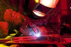 Welder erecting technical steel Stock Images