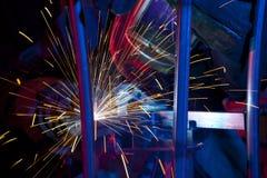 Welder erecting technical steel. Industrial steel welder in factory technical Royalty Free Stock Images