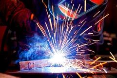 Welder erecting technical steel Stock Photography