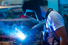 Welder in factory on the machine Royalty Free Stock Photos