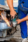 Welder in factory making changes on a car Stock Photo