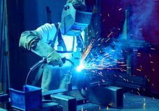 Welder in factory. Man welding metal in the factory Stock Photography