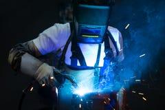 Welder in factory Stock Photos