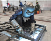 Welder in factory Stock Photo