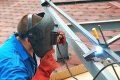 Welder working with metal construction. Welder at the factory working with metal construction Stock Images