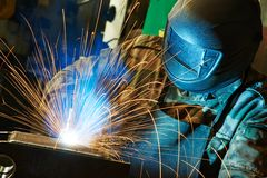 Welder at factory workshop Stock Image