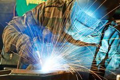 Welder at factory workshop Royalty Free Stock Photo