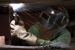 Welder and fire Stock Photo