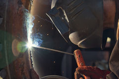 The welder is gaining increased cladding weld Royalty Free Stock Images