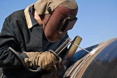 Welder of the gasmain. Gas pipeline, welding Royalty Free Stock Photography