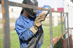 Welder hammering Royalty Free Stock Photos