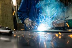 Welder in his workshop welding metal Stock Images