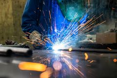 Welder in his workshop welding metal royalty free stock image