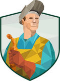 Welder Holding Welding Torch Low Polygon. Low Polygon style illustration of welder worker working holding welding torch viewed from front set inside shield crest Stock Photography