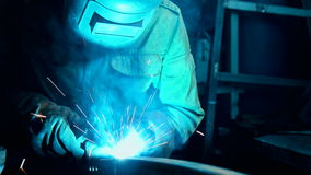 Welder Industrial automotive part in factory stock video footage