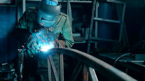 Welder Industrial automotive part in factory stock footage