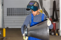 Welder inspecting   metal piece for quality control Stock Photography