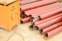 Welder and iron tube Royalty Free Stock Photography