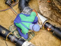 Welder joining heating installation pipes stock photography