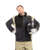 Welder man holding welding mask Stock Photos