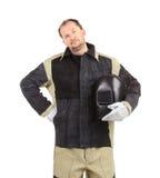 Welder man holding welding mask Stock Photos